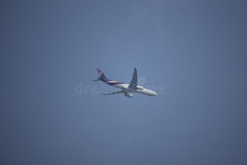 HS-TEU Airbus A330-300 of Thaiairway TG111. CHIANG MAI, THAILAND - AUGUST 26 2017: HS-TEU Airbus A330-300 of Thaiairway TG111. Take off from Chiangmai airport to stock photos