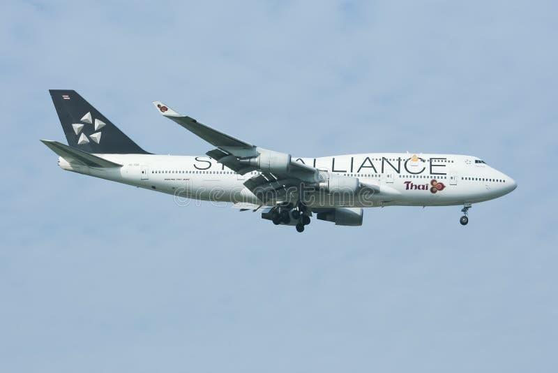 Hs-TGW Boeing 747-400 van Thaiairway (Verf ster-Alliance) stock afbeeldingen