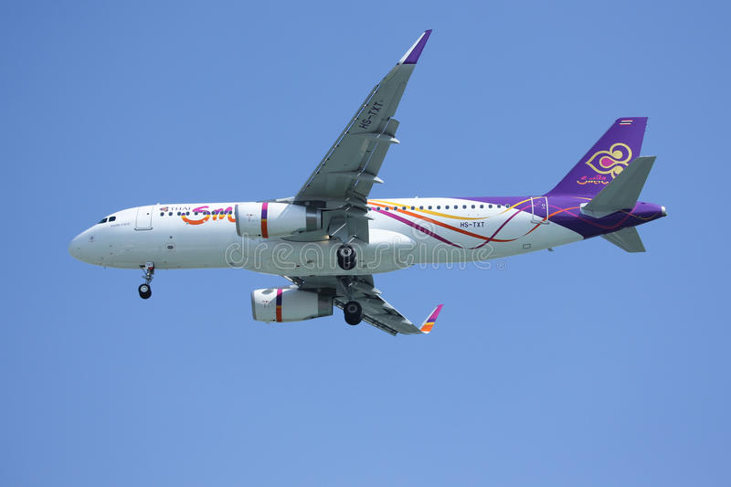 HS-TXT Airbus A320-200 of Thaismile airway. CHIANGMAI, THAILAND -DECEMBER 16 2015: HS-TXT Airbus A320-200 of Thaismile airway. Landing to Chiangmai airport from royalty free stock photo