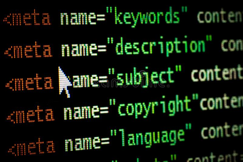 HTML web page computer programming code meta tags in red light and dark green with mouse pointer on black background seo stock image