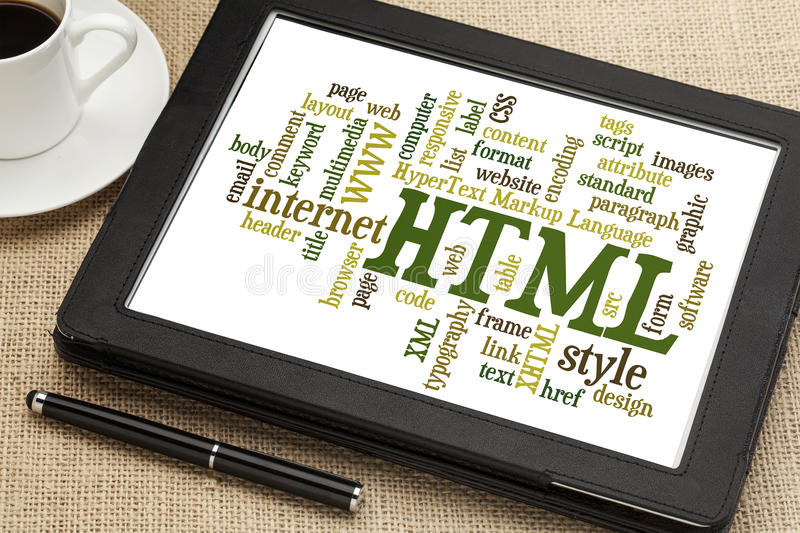 Html word cloud. Html (hypertext markup language) word cloud on a digital tablet with a cup of coffee royalty free stock image