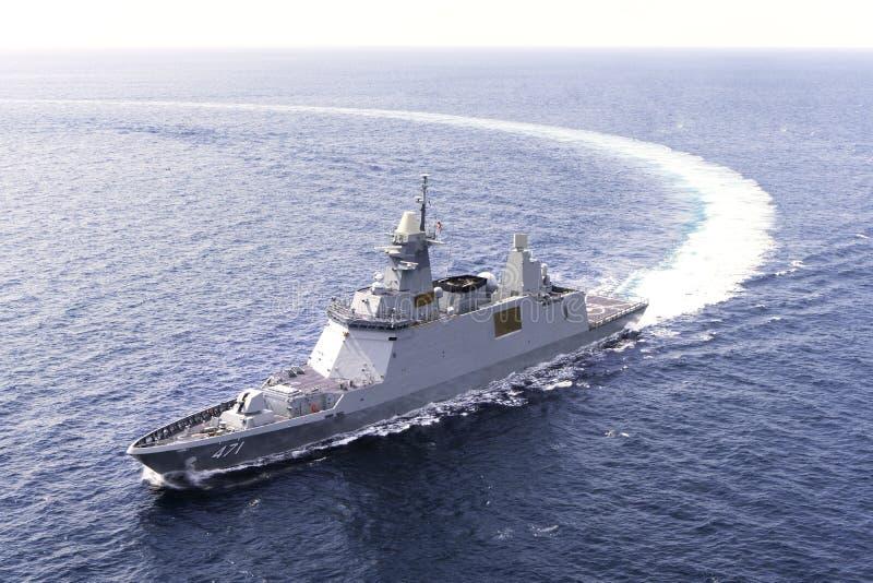 HTMS Bhumibol Adulyadej FFG471 stealth frigate of Royal Thai Navy sails in the sea. ANDAMAN SEA, THAILAND - APRIL 9, 2019 : HTMS Bhumibol Adulyadej FFG471 royalty free stock photo