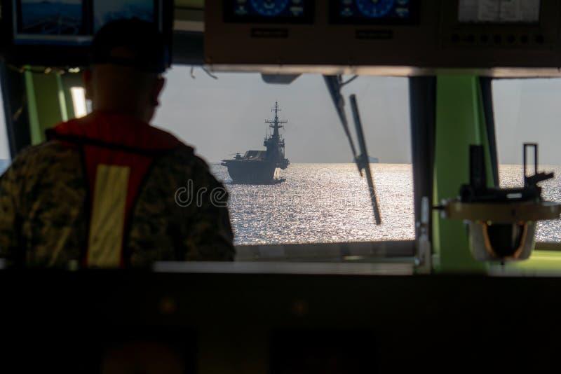 HTMS Chakri Naruebet Aircraft carrier of Royal Thai navy anchors at Andaman Sea view form another warship`s bridge stock photos