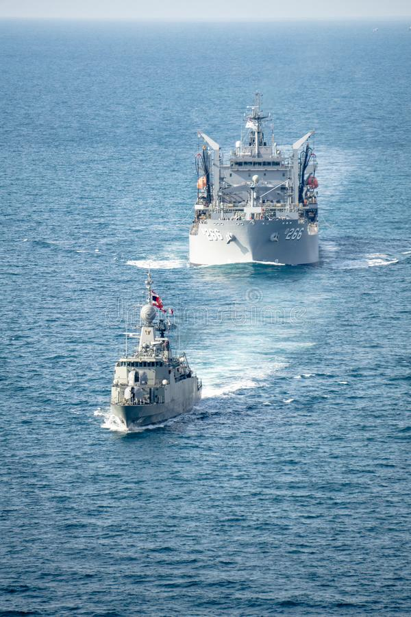 HTMS Rattanakosin Royal Thai Navy corvette sails with HMAS Sirius Royal Australian Navy support ship during AusThai 2019 exercise stock photos
