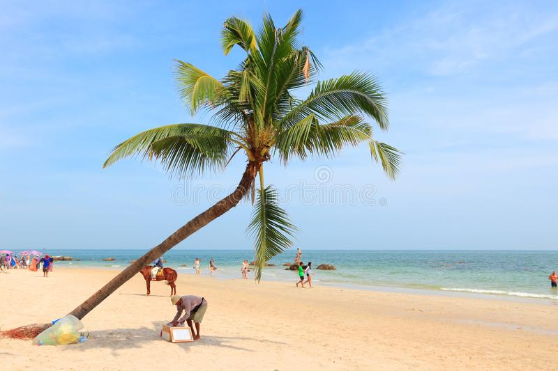 Hua Hin beach. HUA HIN, THAILAND - DECEMBER 14, 2013: People visit sandy beach in Hua Hin, Thailand. Hua Hin is one of most popular resorts in Thailand with a stock photos