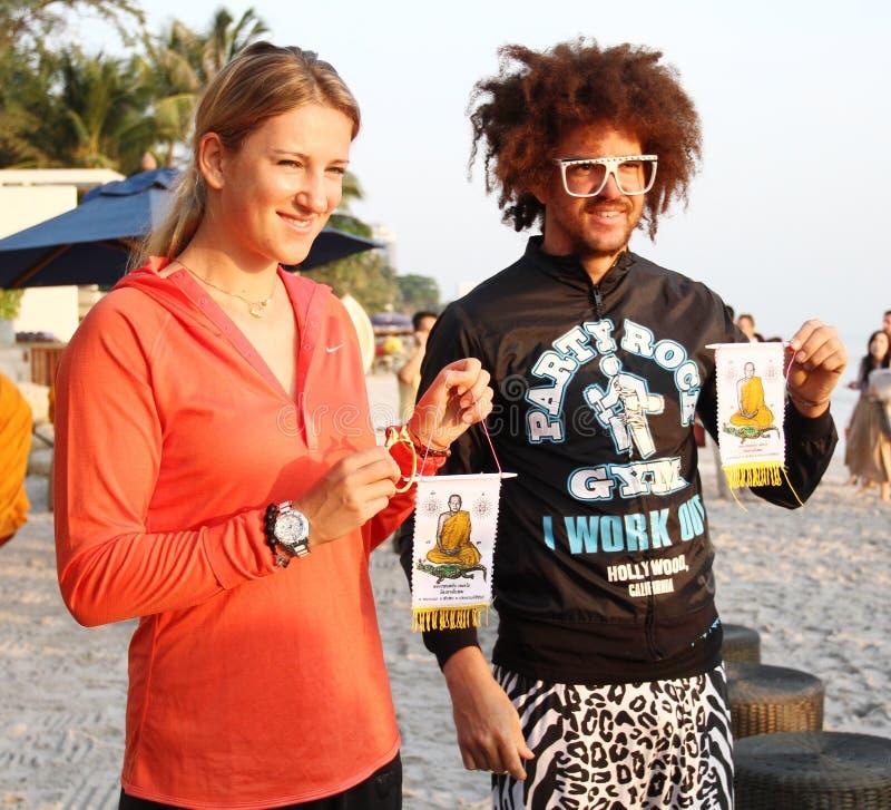 HUA HIN, THAILAND - DEC 28:Victoria Azarenka(pink) of Belarus and Redfoo LMFAO show the ciphers at Intercontinental Hua hin resort royalty free stock image