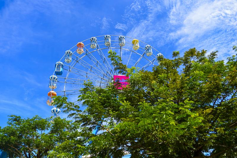 The colorful ferris wheel in Santorini Park, an interesting Greek theme parks and amusement parks in Thailand royalty free stock image