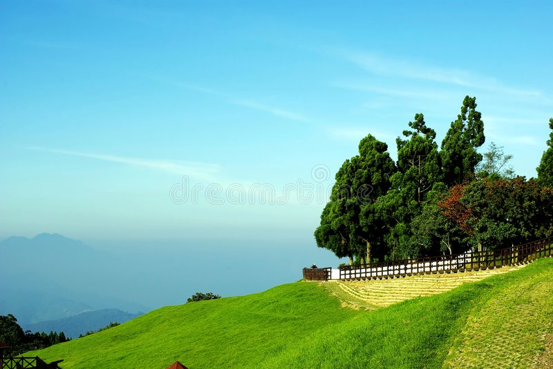 He huan Mountain. Taiwan He Huan Mountain, road along mountain with sky blue royalty free stock photos