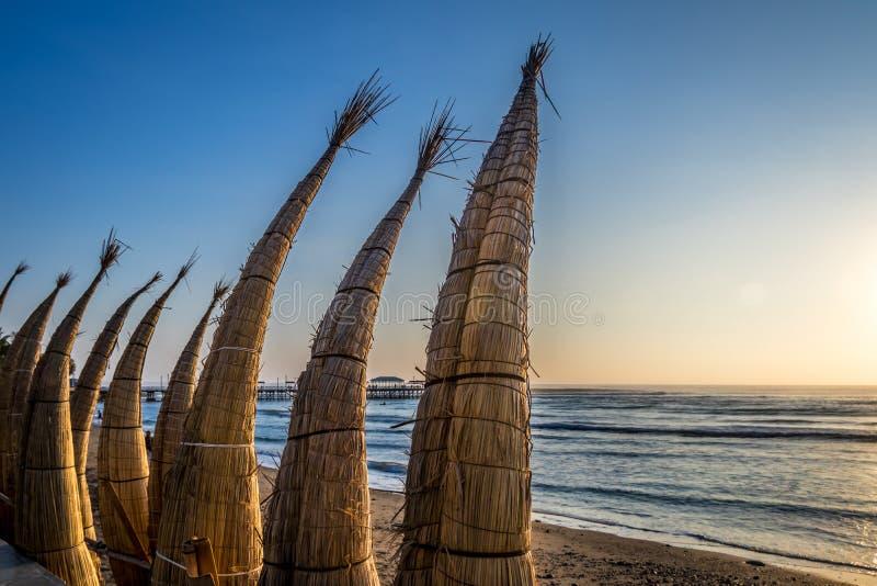 Huanchaco Beach and the traditional reed boats & x28;caballitos de totora& x29; - Trujillo, Peru stock image
