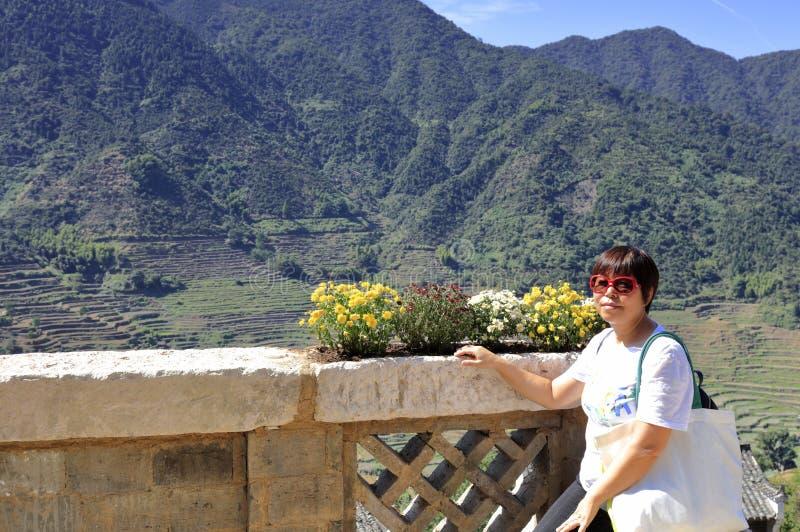 Woman visit huangling mountain, adobe rgb stock photos