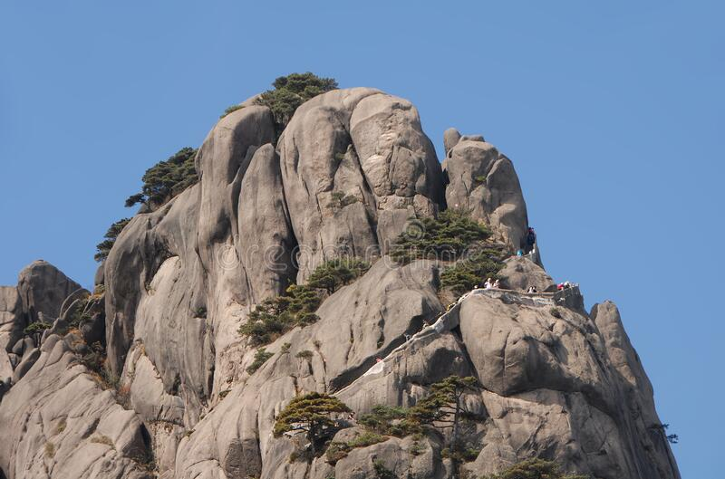 Huangshan Mountain in Anhui Province, China. Close up view of the summit of Lotus Peak, the highest point of Huangshan. Showing summit path. Scenic view of the royalty free stock photos