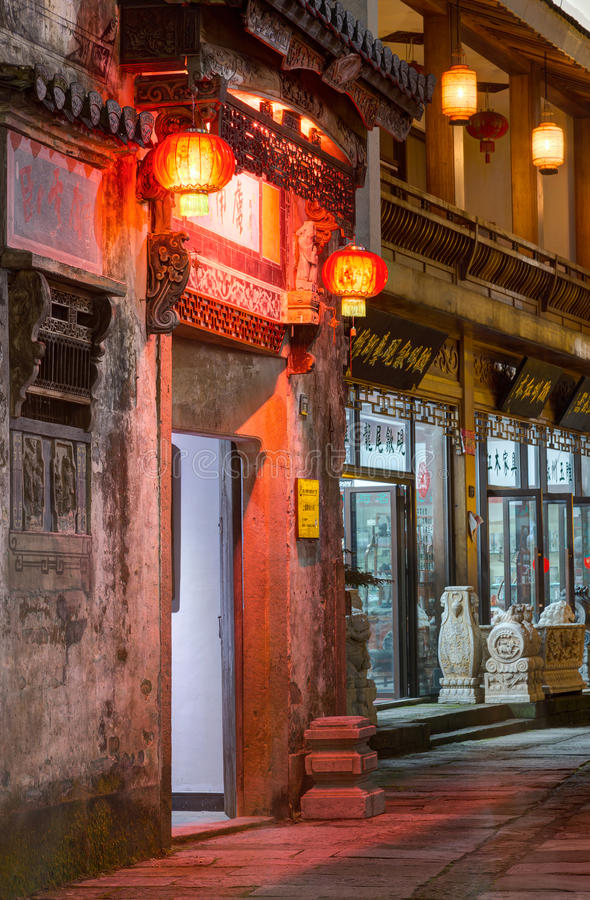 Huangshan Tunxi City, China - circa September 2015: Door portal with oriental asian lanterns at the Old Town Huangshan by night stock photography