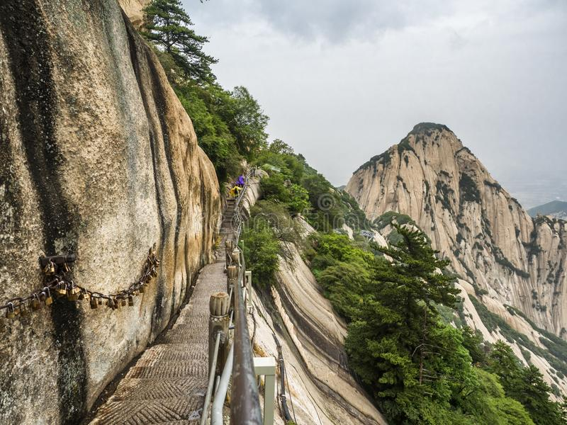 Huashan mountain stairs down view with mist and fog - Xian, Shaaxi Province, China.  royalty free stock photography