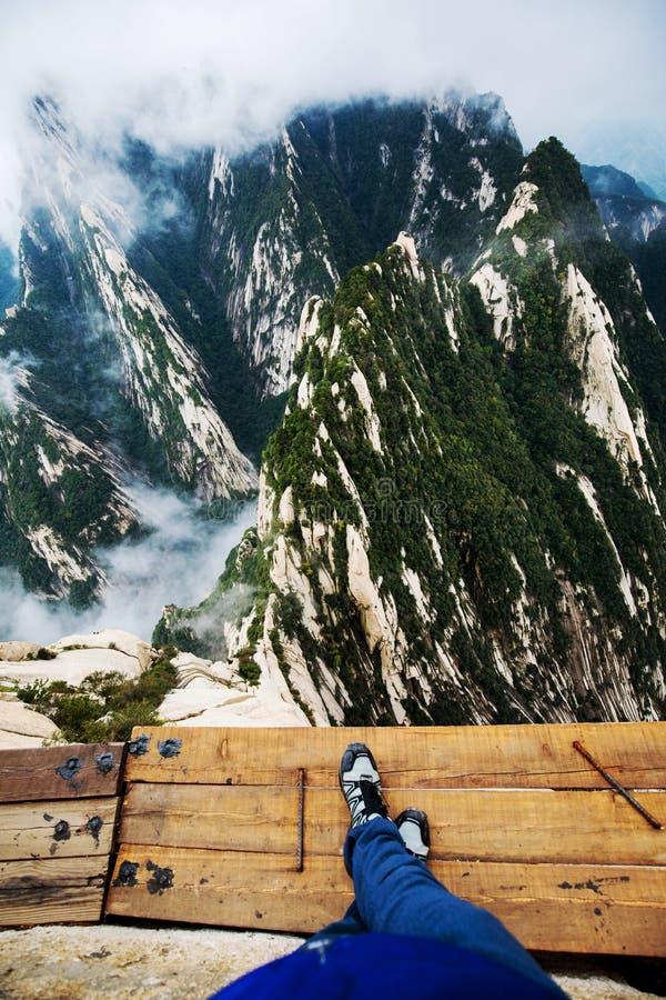 Huashan Plank Walk China with Hiker feet royalty free stock photography
