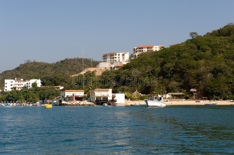 Huatuclo coast Mexico. Scenic view of tourist developments along Huatuclo coast, Oaxaca state, Mexico stock photos