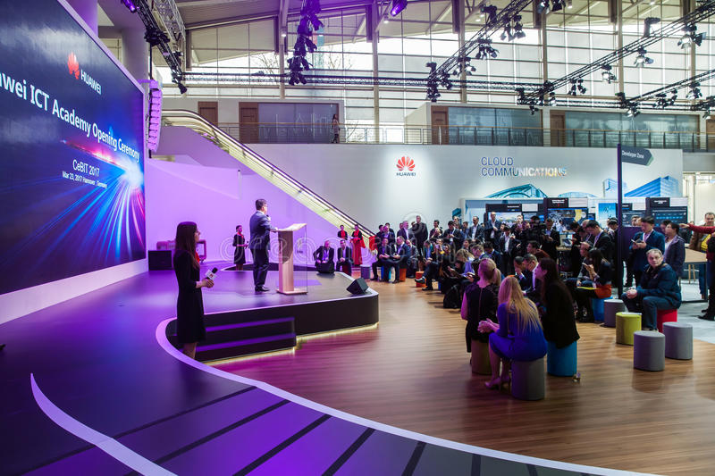 Huawei ICT Academy opening ceremony. Visitors on exhibition Cebit 2017 in Hannover Messe, Germany. Hannover, Germany - March, 2017: Huawei ICT Academy opening stock photo
