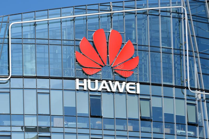 Huawei logo on a building. Vilnius, March 27: Huawei logo on a building on March 27 2018 in Vilnius, Lithuania. Huawei is a Chinese multinational networking and royalty free stock photo