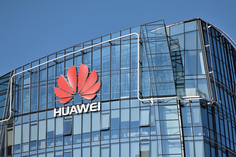 Huawei logo on a building. Vilnius, March 27: Huawei logo on a building on March 27 2018 in Vilnius, Lithuania. Huawei is a Chinese multinational networking and royalty free stock image