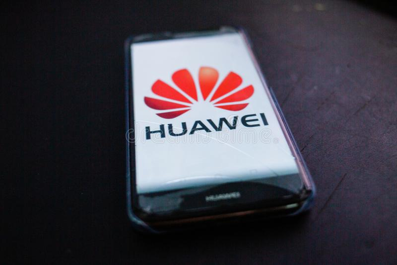 Huawei logo displayed on Huawei smartphone. PERAK, MALAYSIA - MAY 24, 2019: Huawei logo displayed on Huawei smartphone stock images