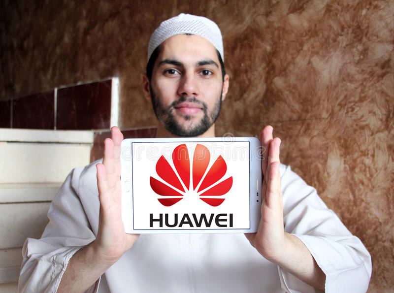 Huawei logo. Logo of mobile company huawei on samsung tablet holded by arab muslim man stock photos