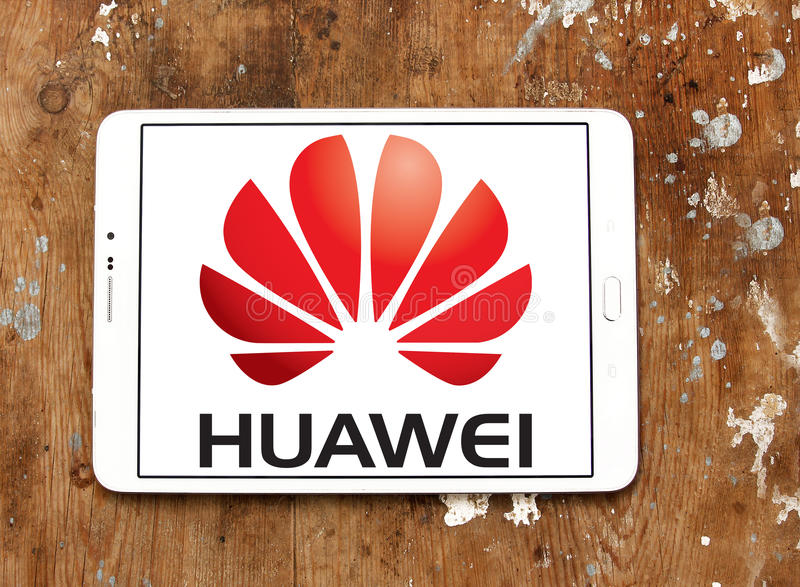 Huawei logo. Logo of mobile company huawei on samsung tablet on wooden background royalty free stock photography