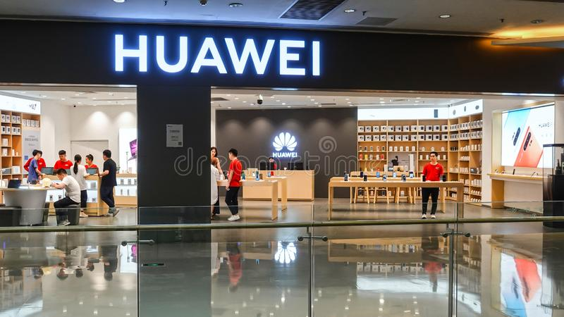 Huawei logo Huawei mobile phone store. Huawei Technology Co., Ltd. is a Chinese communications technology company that produces and sells communications royalty free stock photos