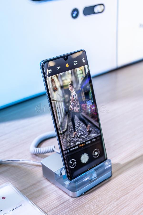 Huawei P30 Pro smartphone, presentation features of P30 Pro with Android at Huawei exhibition pavilion showroom, royalty free stock photos