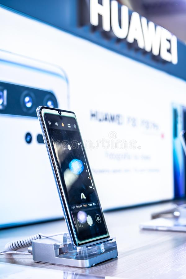 Huawei P30 Pro smartphone, presentation features of P30 Pro with Android at Huawei exhibition pavilion showroom, stock photography