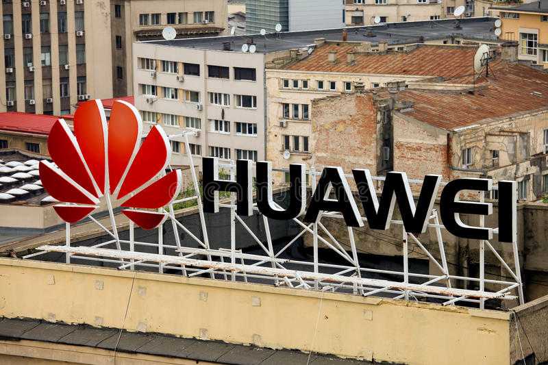Huawei sign on a building. Huawei Technologies Co. is a Chinese multinational networking and telecommunications equipment and services stock images