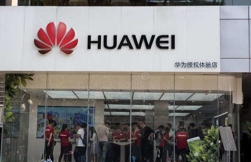 Huawei store, Shanghai China. Customers gather in the Huawei store in Shanghai to view and experience the new P10 mobile phone royalty free stock photography