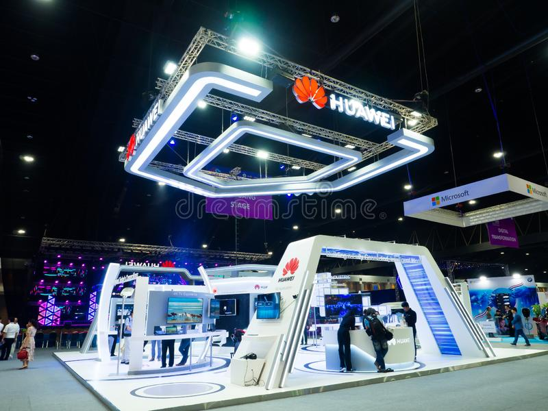 Huawei Technologies Co., Ltd. is a Chinese multinational networking, telecommunications equipment at company Exhibition booth. NONTHABURI, THAILAND – On royalty free stock photography