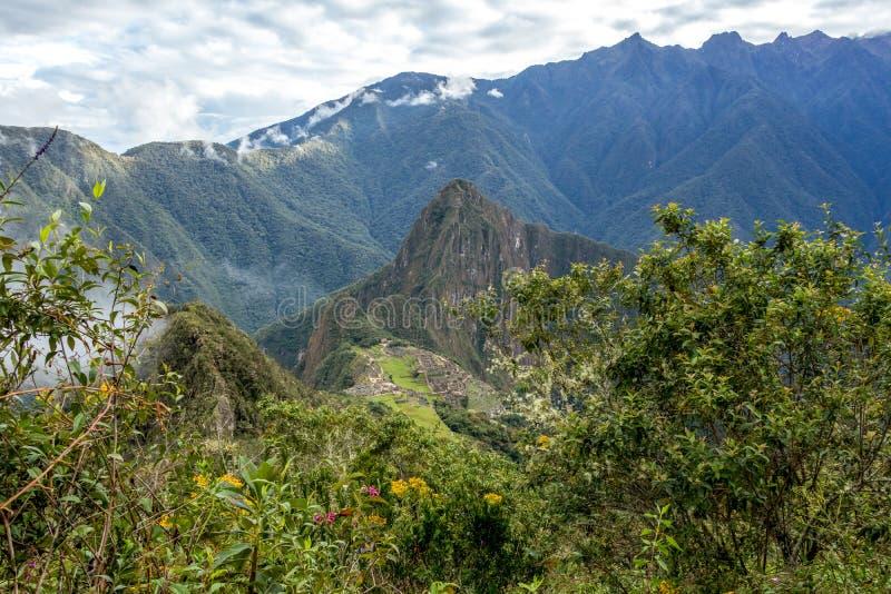 Huayna Picchu, or Wayna Pikchu, mountain in clouds rises over Machu Picchu Inca citadel, lost city of the Incas. Background with Huayna Picchu, Wayna Pikchu stock photo