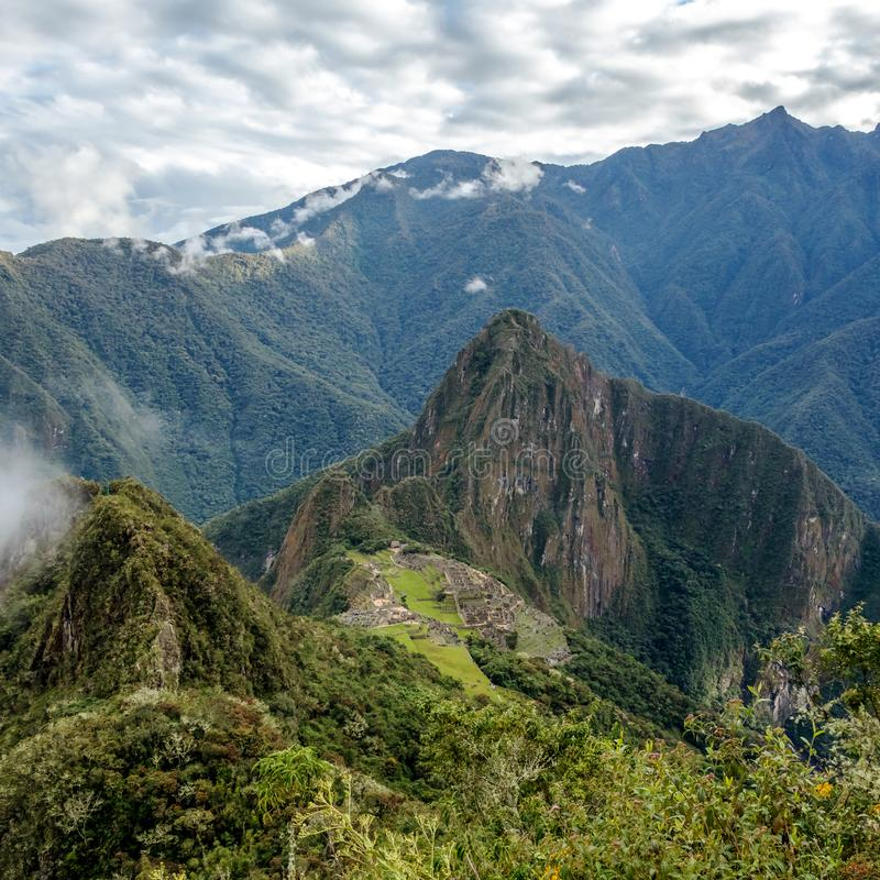 Huayna Picchu, or Wayna Pikchu, mountain in clouds rises over Machu Picchu Inca citadel, lost city of the Incas. Background with Huayna Picchu, Wayna Pikchu stock images