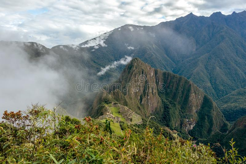 Huayna Picchu, or Wayna Pikchu, mountain in clouds rises over Machu Picchu Inca citadel, lost city of the Incas royalty free stock photos
