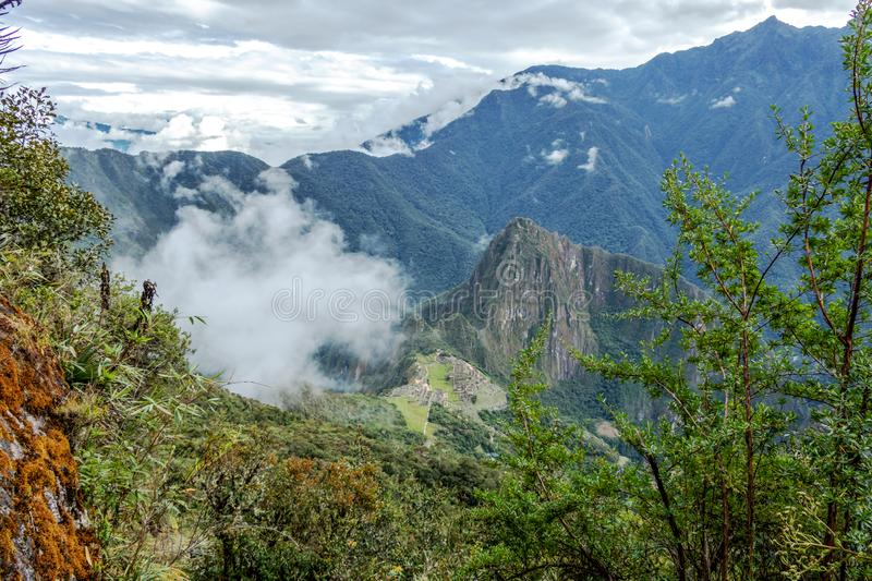 Huayna Picchu, or Wayna Pikchu, mountain in clouds rises over Machu Picchu Inca citadel, lost city of the Incas stock image