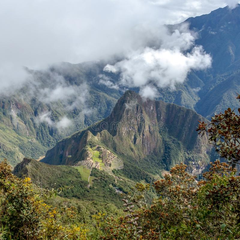 Huayna Picchu, or Wayna Pikchu, mountain in clouds rises over Machu Picchu Inca citadel, lost city of the Incas. Background with Huayna Picchu, Wayna Pikchu royalty free stock photography
