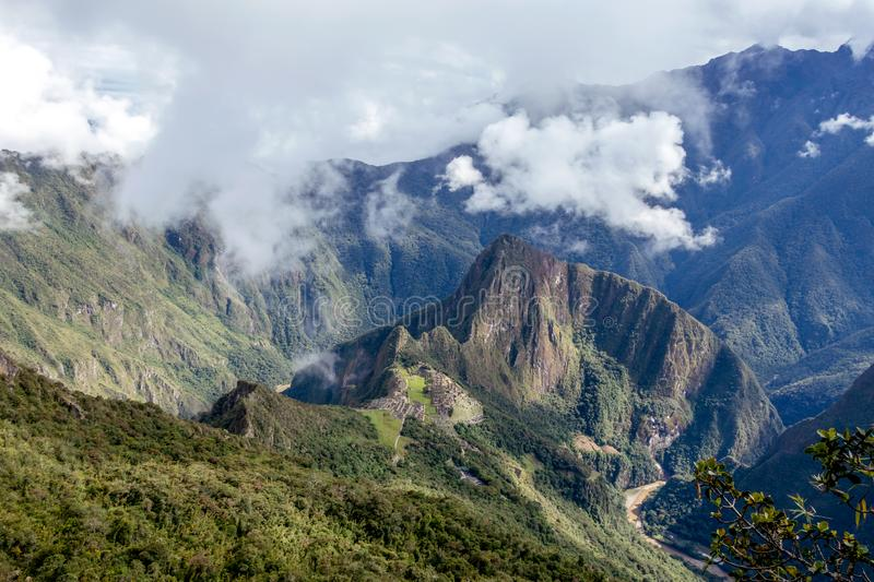 Huayna Picchu, or Wayna Pikchu, mountain in clouds rises over Machu Picchu Inca citadel, lost city of the Incas stock photos