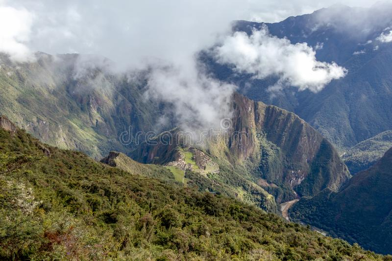 Huayna Picchu, or Wayna Pikchu, mountain in clouds rises over Machu Picchu Inca citadel, lost city of the Incas stock images