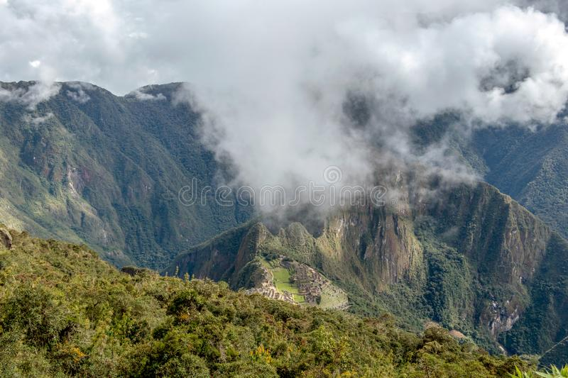 Huayna Picchu, or Wayna Pikchu, mountain in clouds rises over Machu Picchu Inca citadel, lost city of the Incas royalty free stock image