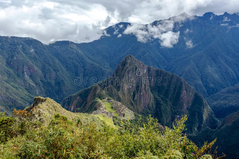 Huayna Picchu, or Wayna Pikchu, mountain in clouds rises over Machu Picchu Inca citadel, lost city of the Incas royalty free stock images