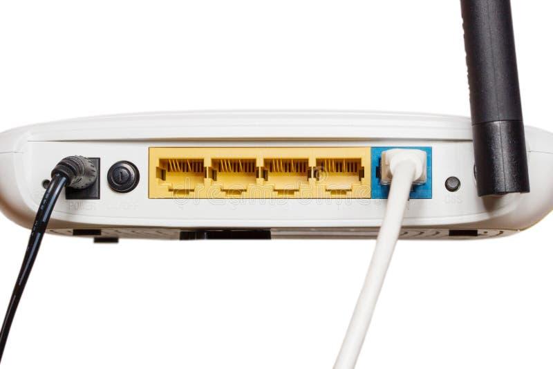 Hub de réseau de routeur avec le cabl de correction photographie stock