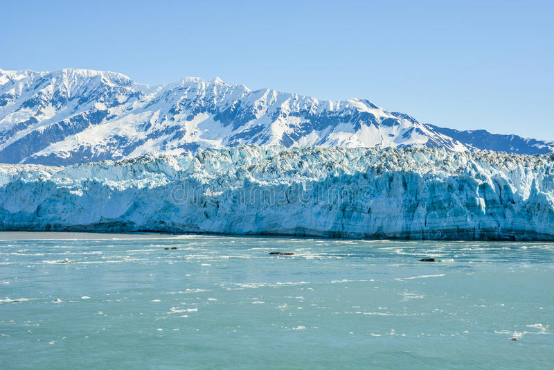 Hubbard Glacier on a cloudy day. Ice chunks of Hubbard Glacier in Alaska, which is the only glacier in the world that is still growing, but when it melts you can stock photography