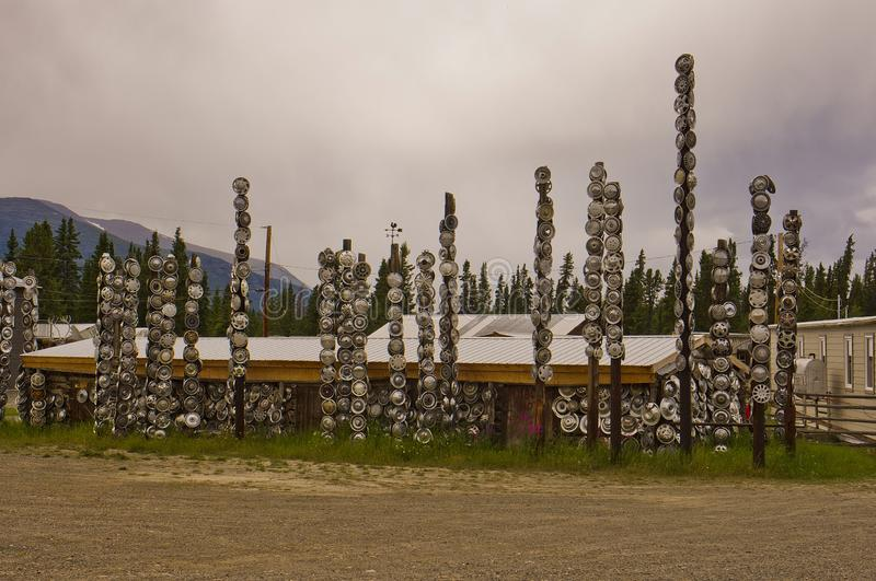 A hubcap forest in the Yukon. A hubcap forest in the town of Champagne, Yukon, Canada stock photos