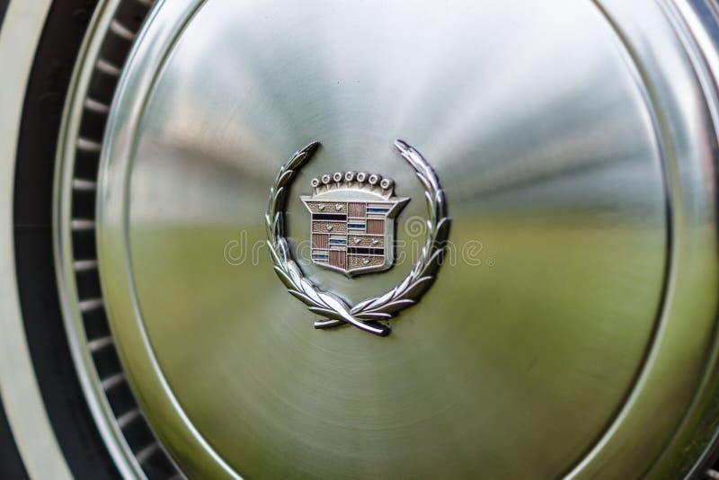 Hubcap of a full-size personal luxury car Cadillac Eldorado. PAAREN IM GLIEN, GERMANY - JUNE 03, 2017: Hubcap of a full-size personal luxury car Cadillac royalty free stock photos