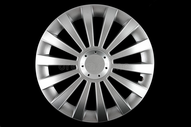 Hubcap isolated. A photo of a hubcap isolated over black background royalty free stock photo