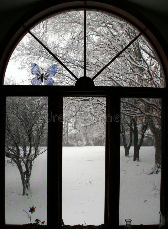 Hublot de l'hiver image stock