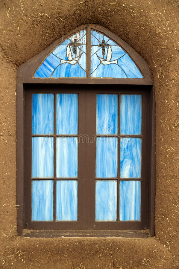 Hublot en verre souillé, San Geronimo, Taos photographie stock