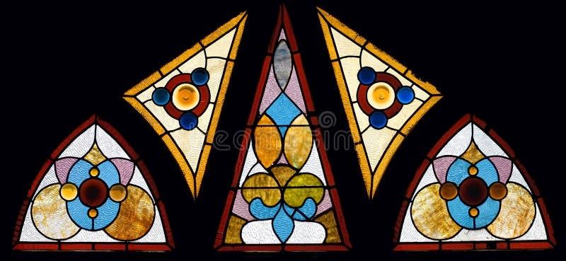 Hublot multi d'église en verre souillé de cru de panneau photo stock