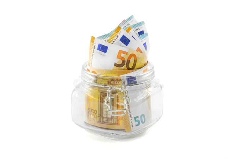 Hucha con euros en un fondo aislado fotos de archivo