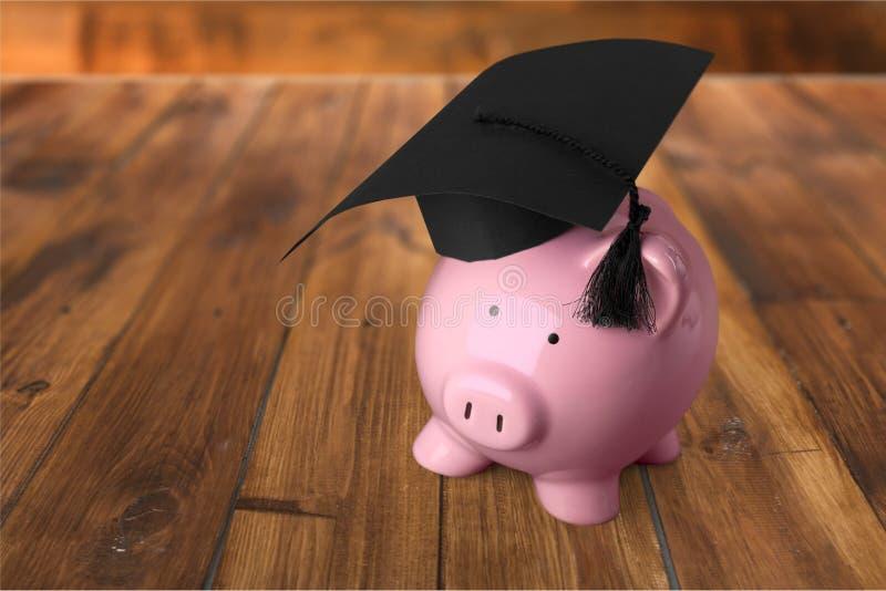Hucha de la graduación foto de archivo